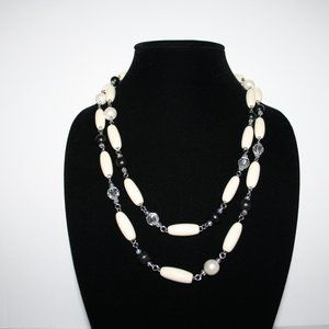 "48"" silver and painted wood necklace"